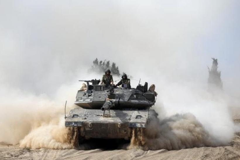Israeli soldiers atop tank
