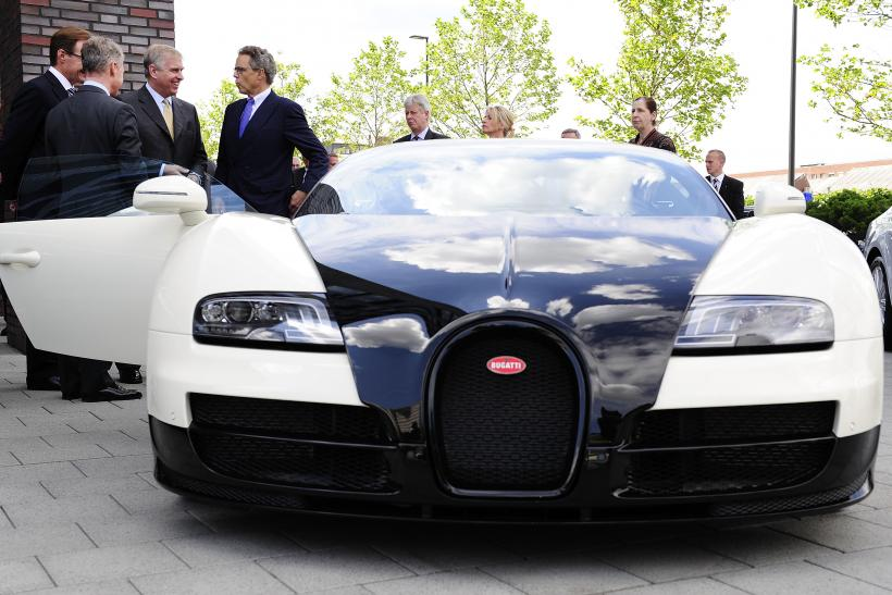 Prince Andrew Duke Of York Stands Next To A Bugatti Veyron Car During His Visit Volkswagen Plant On June 3 2017 In Wolfsburg Germany