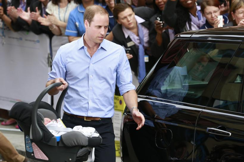Prince William carries Prince George in car seat