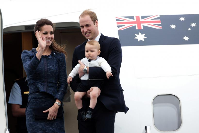 Prince William carrying Prince George