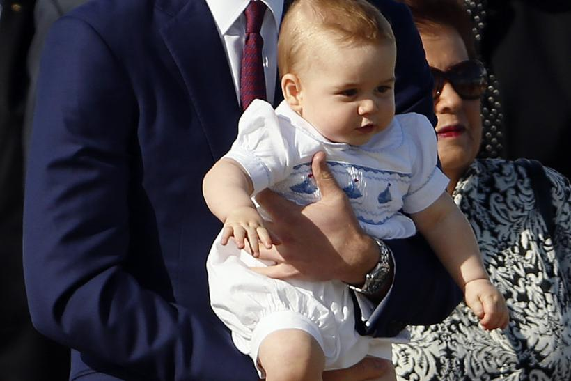 Prince William holding Prince George