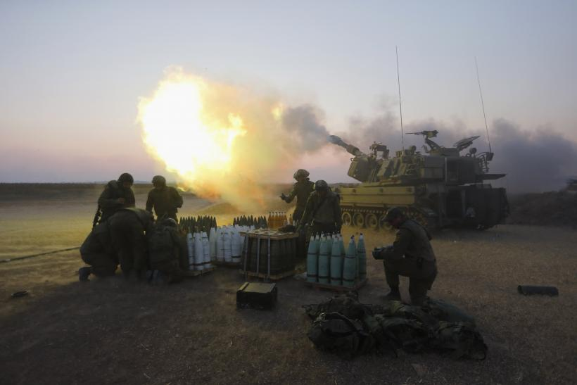 An Israeli mobile artillery unit fires towards the Gaza Strip July 21, 2014.