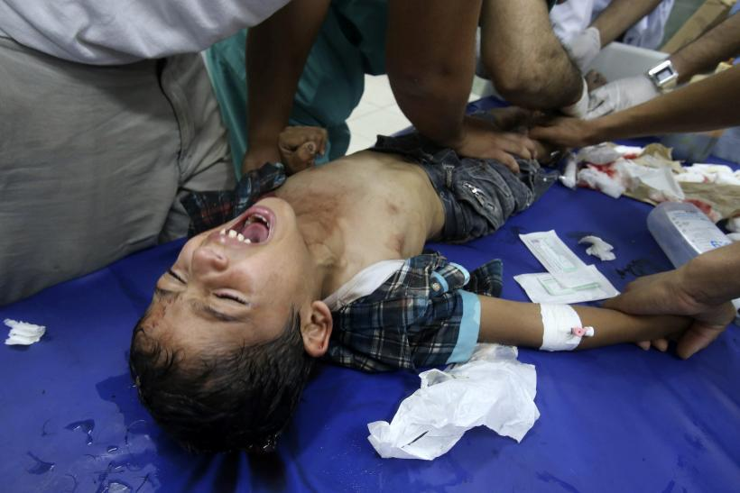 Palestinian medics tend to a boy who they said was wounded in an Israeli shelling, at a hospital, in Rafah in the southern Gaza Strip July 21, 2014.