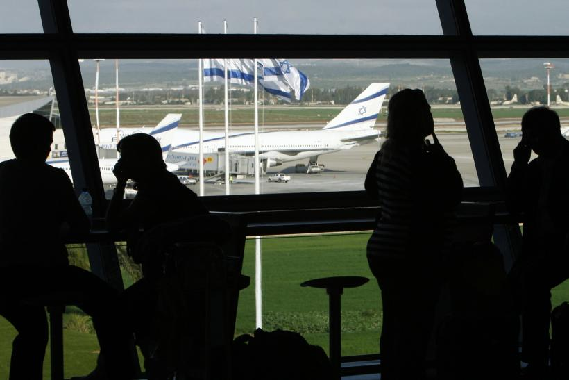 People sit inside Israel's Ben-Gurion International Airport near Tel Aviv in a January 5, 2010 file photo