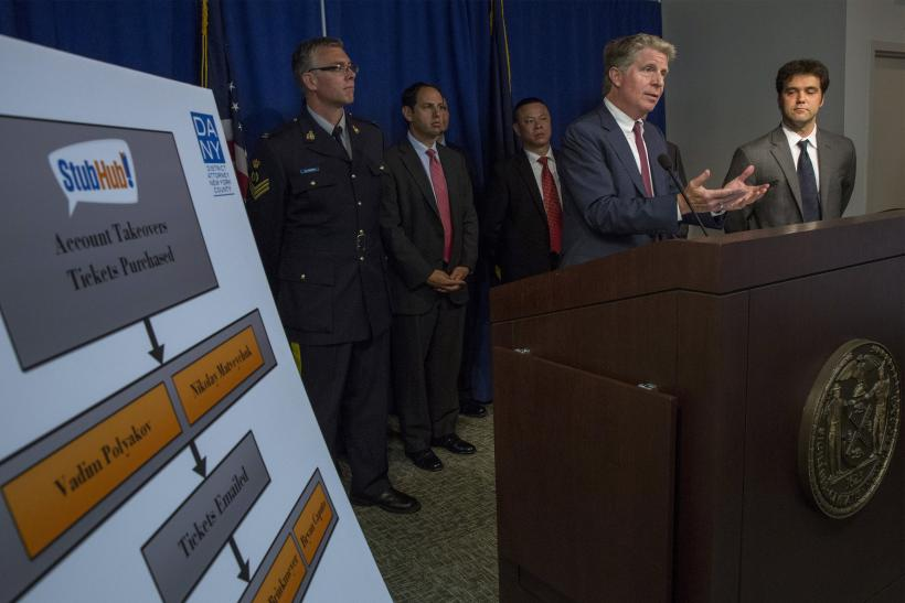 Manhattan District Attorney Cyrus Vance Jr. (2nd R) speaks during a news conference at his office in midtown Manhattan in New York July 23, 2014.
