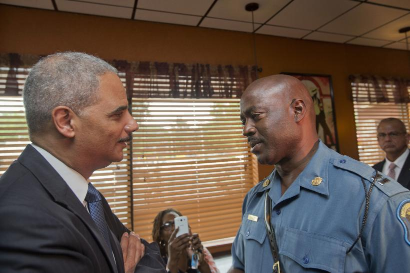 Eric Holder with police captain