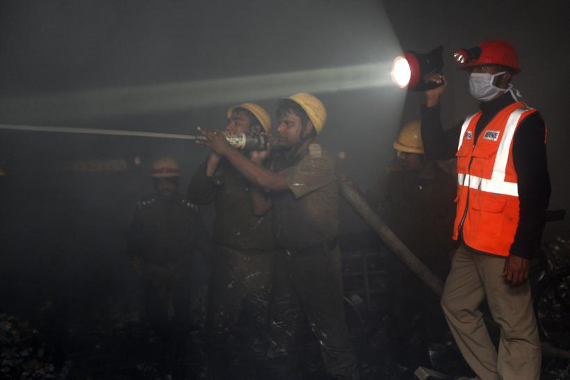 Firefighters at a cloth godown in Kolkata