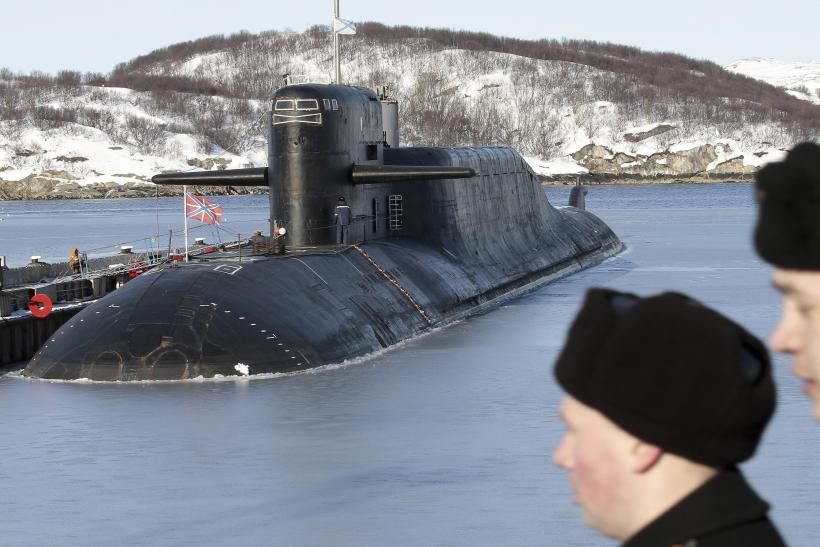 Russian Sailors Look On With Submarine In The Background