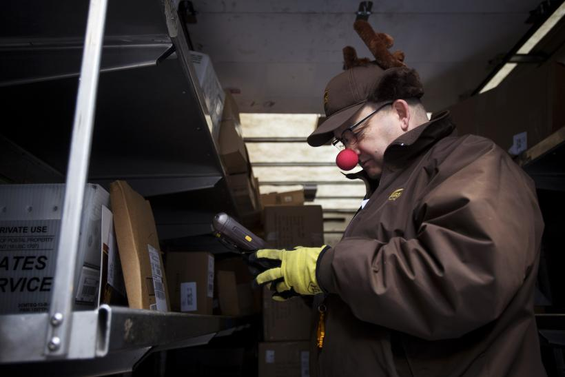 ups delivery man vinny ambrosino prepares to deliver packages on christmas eve while wearing a rudolf nose and antlers in new york dec 24 2013 - Post Office Open On Christmas Eve