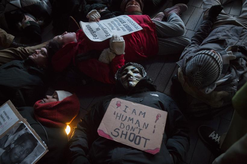 NY protesters stage die in