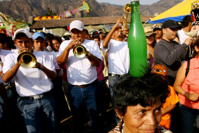 Mexican woman balances soda