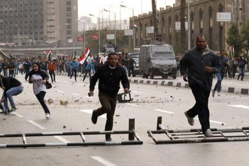 Egypt demonstrations protesters run