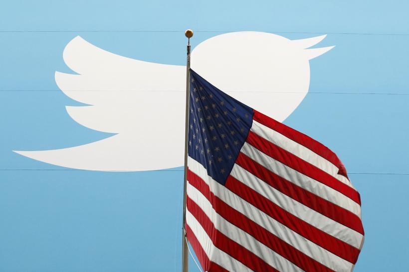 Twitter logo as background to American flag