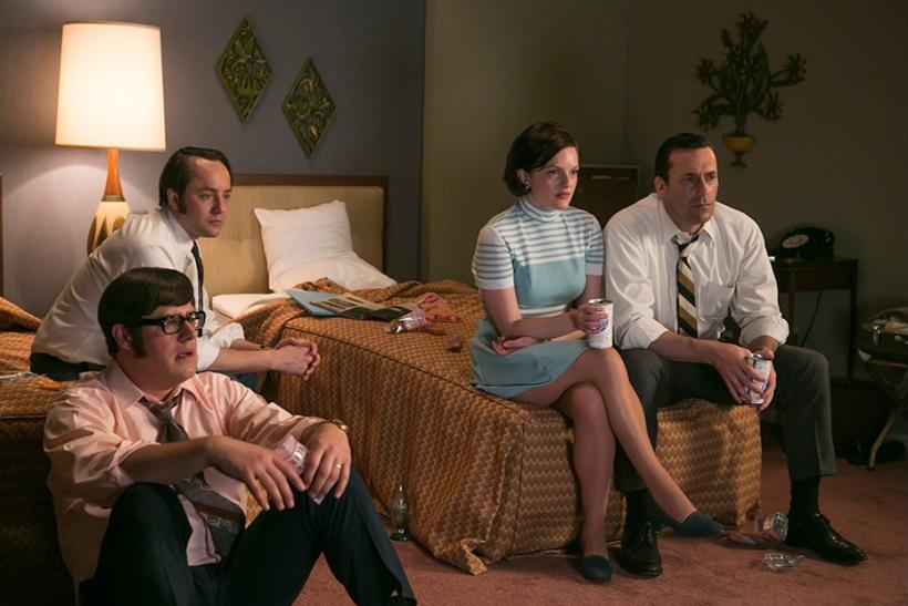 Mad Men's Peggy Olson, Don Draper watching TV