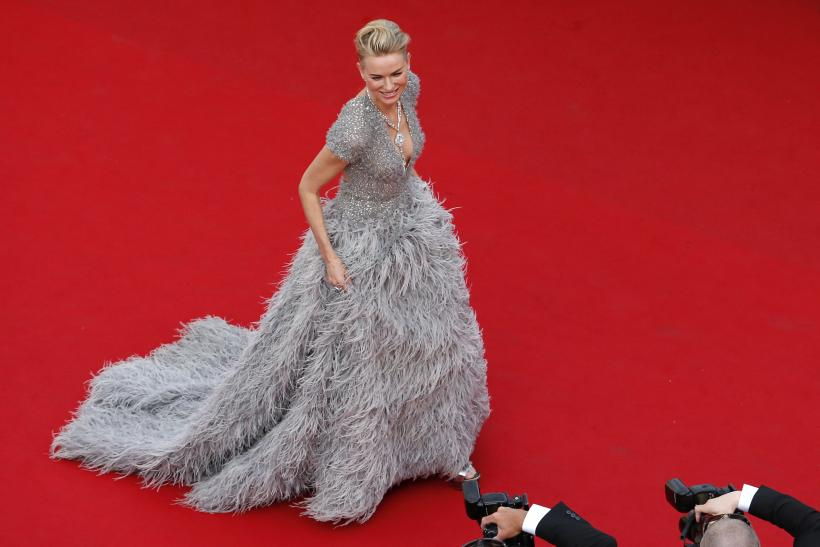 """[14:40] Actress Julianne Moore poses on the red carpet as she arrives for the opening ceremony and the screening of the film """"La tete haute"""" out of competition during the 68th Cannes Film Festival"""