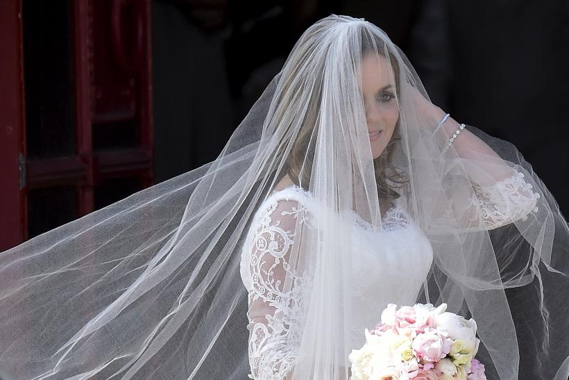 [9:03] British singer and former member of the band Spice Girls Geri Halliwell arrives for her wedding with Formula One motor racing business owner Christian Horner at St. Mary's Church at Woburn