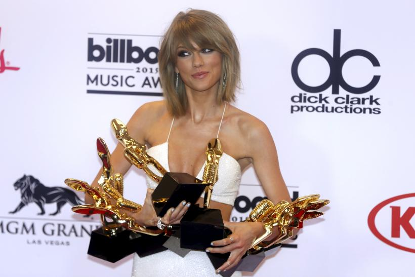 [10:26] Singer Taylor Swift poses backstage with her awards