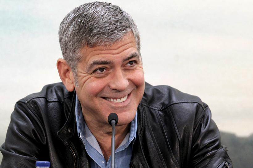 """[8:28] Cast member George Clooney talks to the media during a news conference at the City of Arts and Sciences ahead of the premiere of the movie """"Tomorrowland"""" in Valencia"""