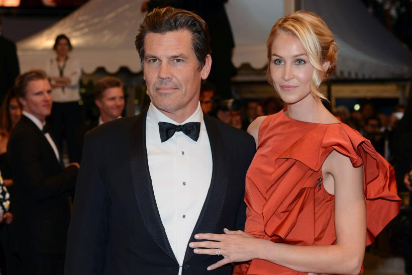 "[9:39] Cast member Josh Brolin (L) and his girlfriend Kathryn Boyd pose on the red carpet as they leave after the screening of the film ""Sicario"""