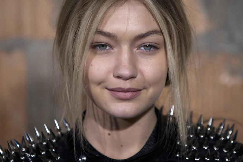 [8:09] Model Gigi Hadid poses for a photo before the Diesel Black Gold Fall/Winter 2015 collection show during New York Fashion Week