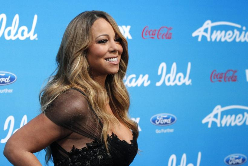 "Judge Mariah Carey poses at the party for the finalists of the television show ""American Idol"" in Los Angeles, California March 7, 2013."