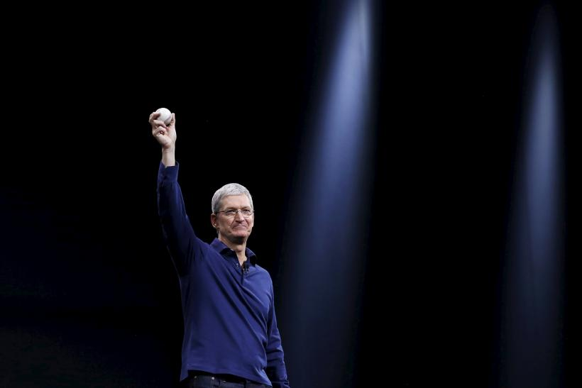 Apple CEO Tim Cook holds up a baseball as he delivers his keynote address at WWDC 2015