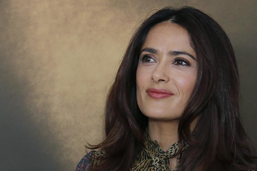 "[8:32] Actress Salma Hayek poses during a photocall ahead of a debate ""Kering Women in Motion"" at the 68th Cannes Film Festival in Cannes"