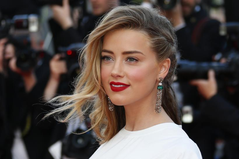 """[11:00] Amber Heard poses on the red carpet as she arrives for the screening of the film """"Deux jours, une nuit"""" (Two Days, One Night) in competition at the 67th Cannes Film Festival"""