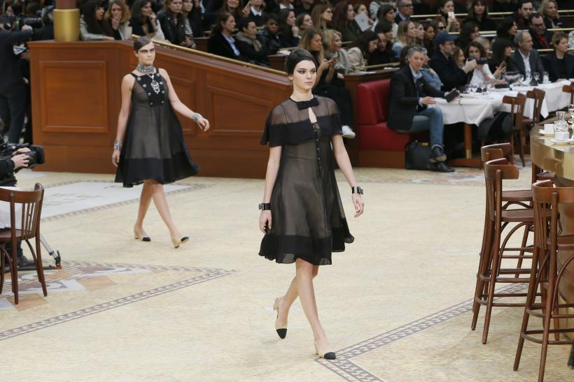 [13:13] Models Cara Delevingne (left) and Kendall Jenner present creations by German designer Karl Lagerfeld as part of his Autumn/Winter 2015/2016 collection