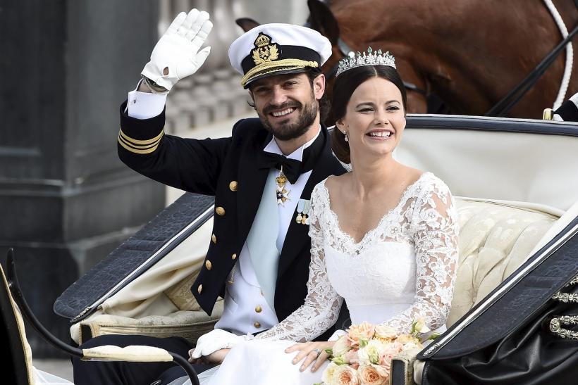 [10:30] Swedish Prince Carl Philip and Sofia Hellqvist smile in the carriage during their wedding in the Royal Chapel in Stockholm