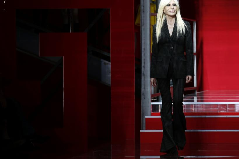 [8:23] Italian designer Donatella Versace acknowledges the applause at the end of Versace Autumn/Winter 2015 /16 collection during Milan Fashion Week