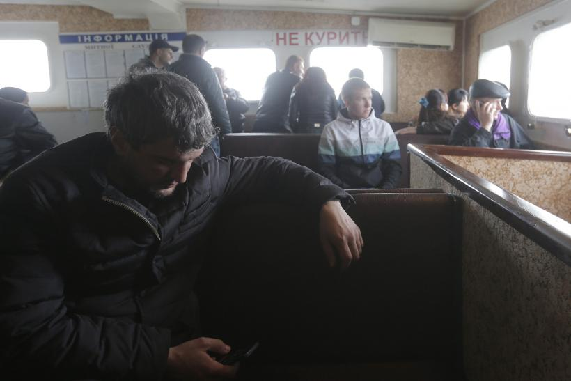 People travel by boat from Russia to Crimea.