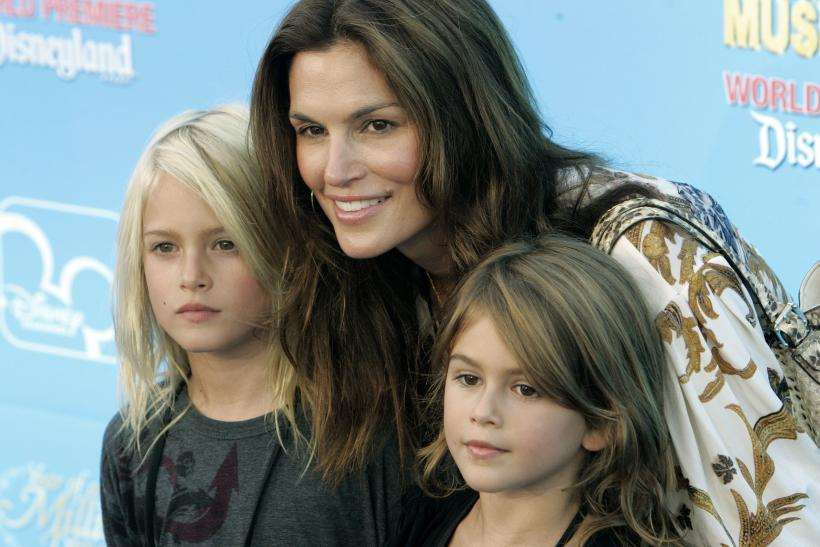 "[8:31] Model Cindy Crawford poses with her children son Presley (L) and daughter Kaia at the premiere of the Disney Channel movie ""High School Musical 2"" at Downtown Disney in Anaheim"