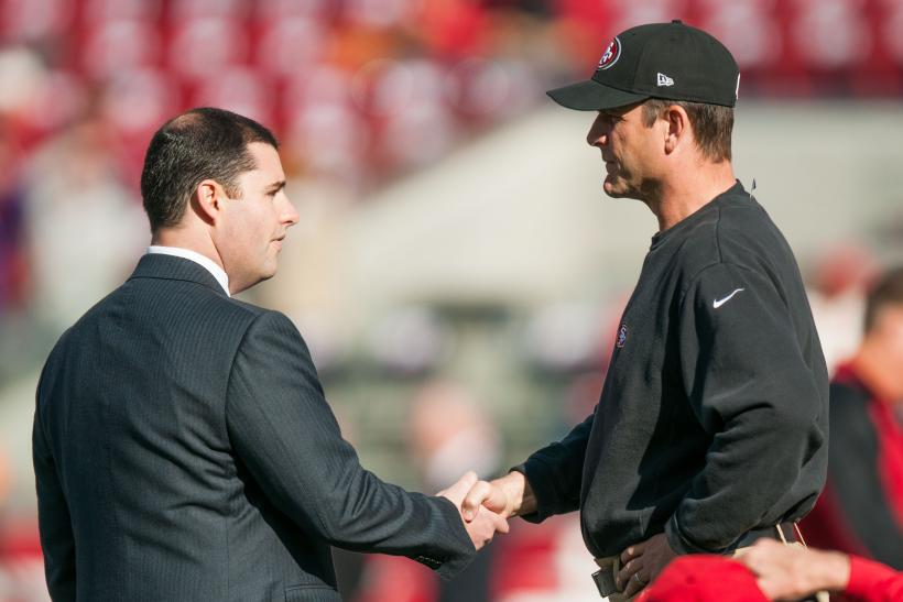 Jed York and Jim Harbaugh in 2014