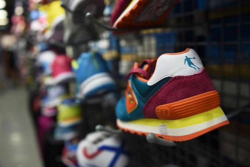 online retailer 8f857 fca5b A Qiaodan brand shoe is seen in a store in Beijing on July 29, 2015. A  Beijing court has dismissed a trademark case brought by US basketball  superstar ...