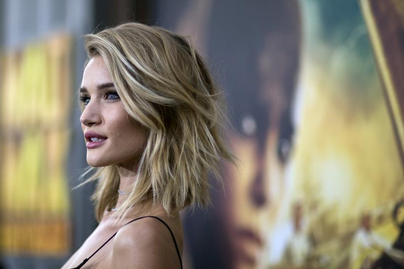 [15:53] Cast member Rosie Huntington-Whiteley poses at the premiere of 'Mad Max: Fury Road'