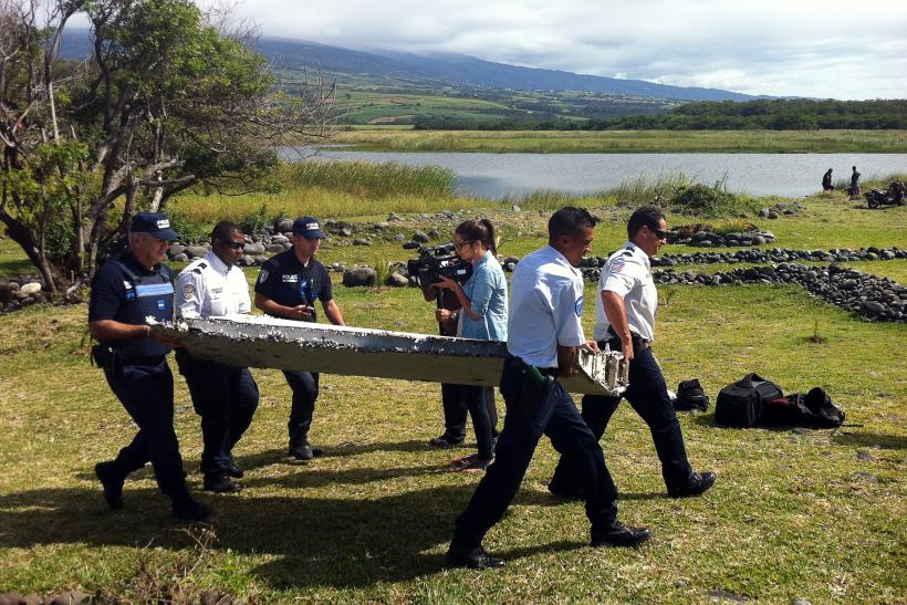 Flight mh 370 found malaysia airlines debris confirmed to be from police carry a piece of debris that on wednesday was confirmed to be part a wing from malaysia airlines flight 370 which went missing in the indian ocean publicscrutiny Gallery