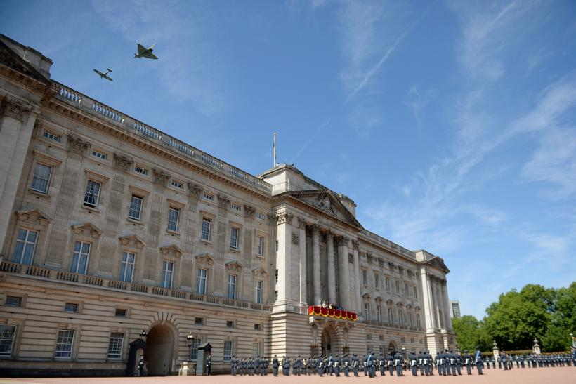[12:04] A RAF flypast of one Spitfire and a Typhoon aircraft passes over Buckingham Palace