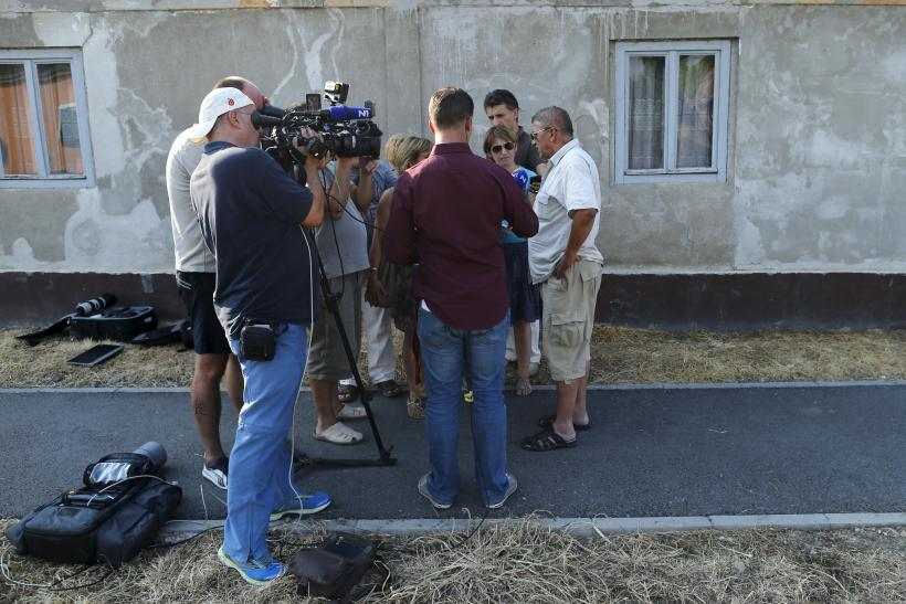 Camera crews speak with Tomislav Salopek's friends.