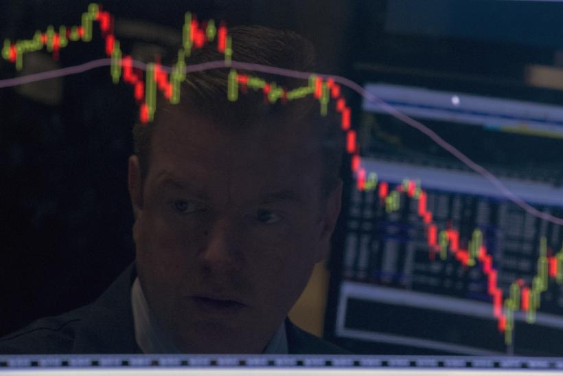 A trader looks on as stocks recover.