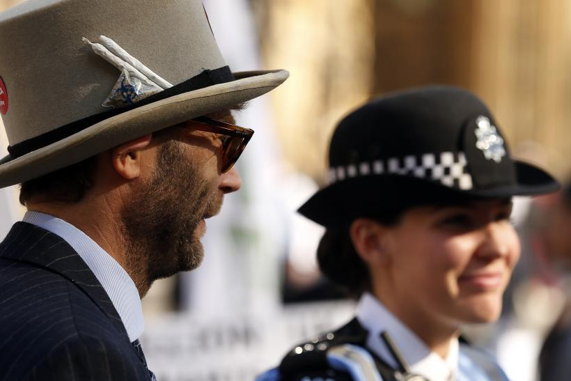 A campaigner and police officer stand side by side