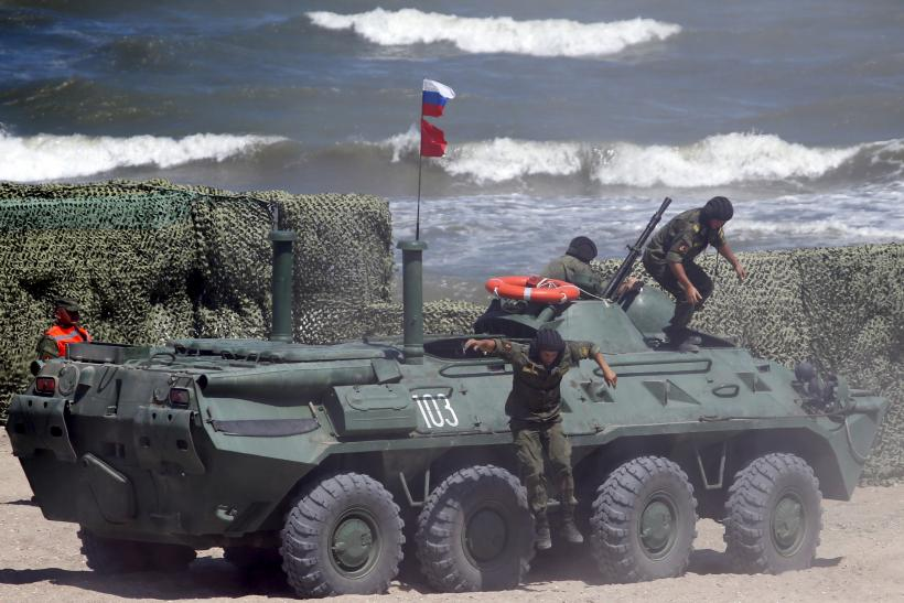 Russian soldiers operating on an armored personnel carrier