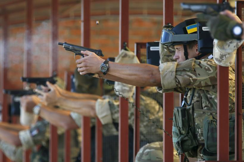 Soldiers from Ukraine's National Guard fire at a training session.