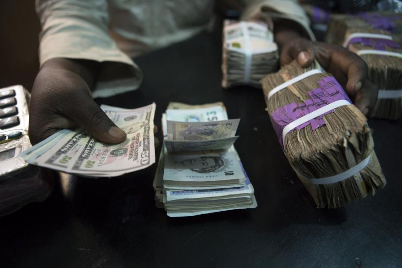 U.S. dollars and Nigerian naira