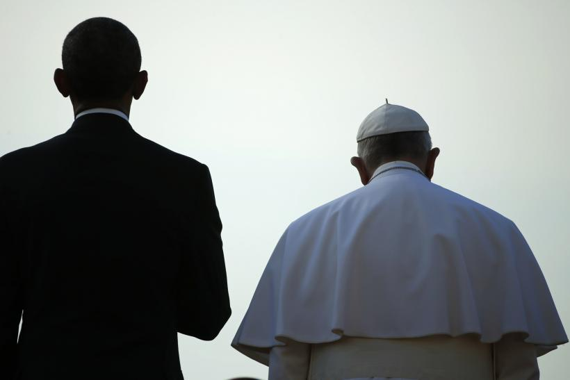 Pope Francis next to Obama