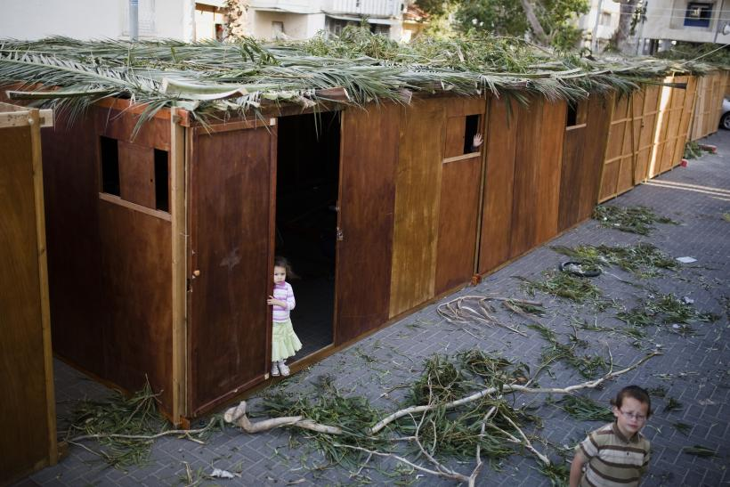 Children playing nearby Sukkahs as the Jewish community celebrates the festival of Sukkot