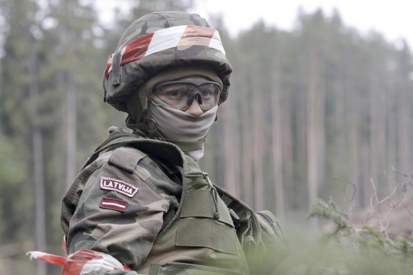 A Latvian soldier stands during a training exercise.