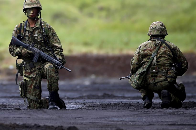 Japanese soldiers kneel during a training exercise