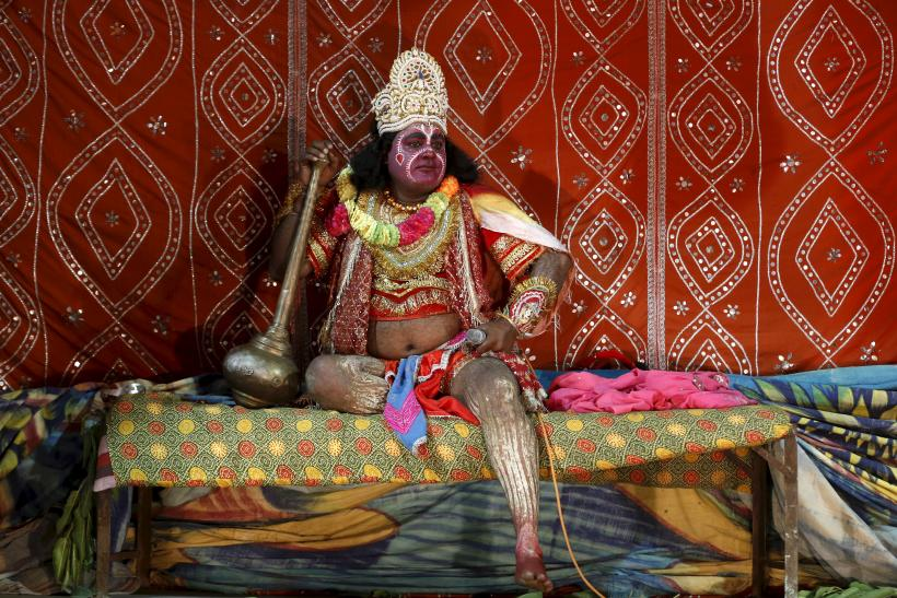 A man dressed as the Hindu monkey god Hanuman