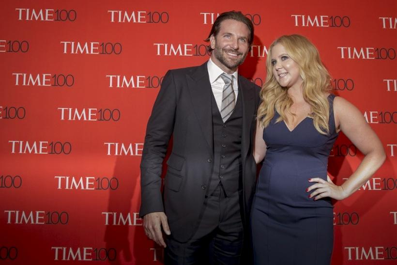 Bradley Cooper (L) and Amy Schumer